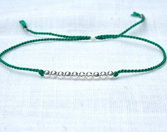 Green silk thread bracelet with 10 Sterling Silver round beads
