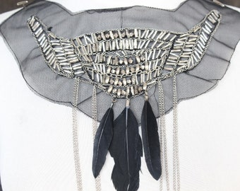 Cute embroidered   and beaded  applique with feather and chain