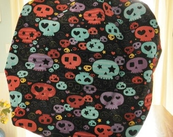 Colorful Skulls on  black Banded Bouffant Surgical Cap by Nurseheadwear Bakers Cap
