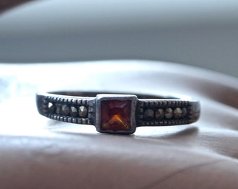 Sterling Silver and Square Garnet  Band Ring with Marcasites marked 925 size 7.75
