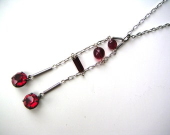 art deco red and sterling silver pendant necklace lavalier balancing