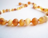 Maximum Effective Raw Unpolished Baltic Amber teething necklace for your baby handmade knotted .Light  multicolor amber.