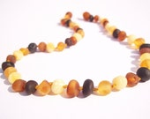 Maximum Effective Raw Unpolished Baltic Amber teething necklace for your baby handmade knotted . Multicolor