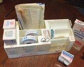 Johnson & Johnson Home Wound Care Center, holds Band-Aid Brand Adhesive Bandages and other medical supplies