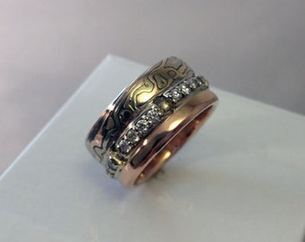 Truely unique mokume gane 14k white gold 14k red gold with sterling silver with eternity style diamonds
