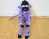 Purple jelly bean sock monkey - purple body with pink, green, and black polka dots