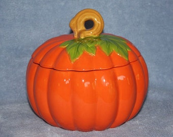 Ceramic Harvest Pumpkin Container with green leaves and an easy to handle stem to easily open and close the dish