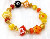Bright Yellow Red Orange and Black Bracelet, 6 1/4 inches (15.8cm) S to M, Handmade Glass Beads with Gold Accents on Stretch Elastic Cord