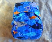 SassyCloth one size pocket diaper with sharks on blue cotton print. Made to order.