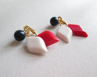 Black, White, and Red Trifari Clip on Earrings