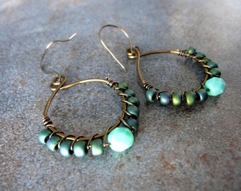 Wire wrapped teal, blue and bronze beaded earrings
