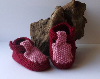 Hand knitted baby girls T-strap shoes. 0 - 6 months. Anti tickle merino wool. Fuschia and pink.