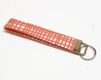 key fob key chain lanyard wristlet orange white geometric