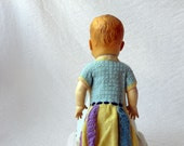 Vintage baby doll, 1950s Reliable Doll , in grandmother-made knitted dress.