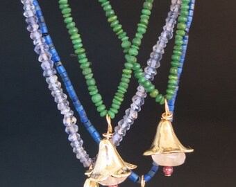 Jade, Lapis Lazuli and Iolite gold flower necklace with rose quarts and garnet bead