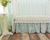 Bumperless Crib Bedding in Aqua, Coral, and Gold with a Hot Air Balloon Theme