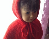 American Girl is red riding hood in her red hooded cape.