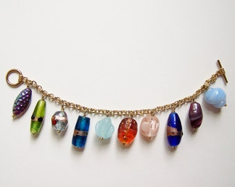 GLASS CHARM BRACELET - 10 Colorful & Distinctive Handmade Glass Beads on Gold Plated Chain with Toggle Clasp