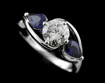 Crossover Split Shank Forever One Moissanite By Charles & Colvard Pear Shape Blue Sapphire Three Stone Engagement Ring 14k White Gold