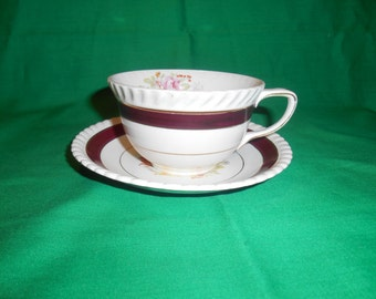One (1), Flat Tea Cup & Saucer, from Johnson Bros., in the JB 117 Pattern.