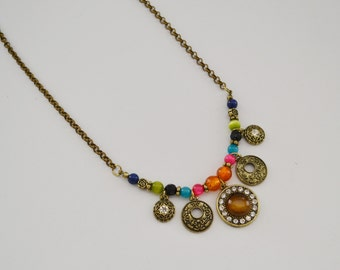 multicolored bead and bronze charm necklace