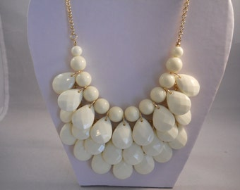3 Later Cream Color Bib Necklace with Teardrop Beads on a Gold Tone Chain