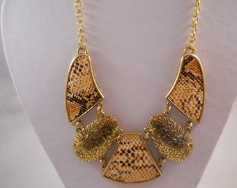 Bib Necklace with Gold Tone and Speckled Tan Pendants on a Gold Tone Chain