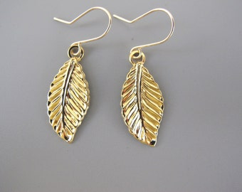Leaf dangle Earrings, gold hammerd leaf earrings for every day.