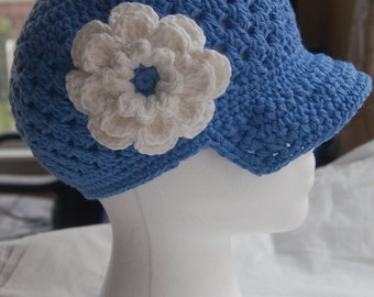 Adult Newsgirl style hat with visor. Removable flower clip.