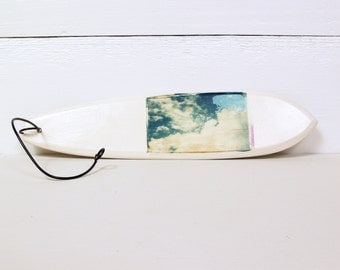 Surfboard.   Clouds.  Polaroid Transfer Printed on Hand-Sculpted Fired Clay Surfboard.