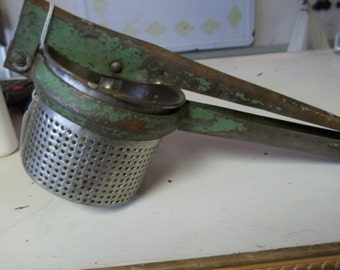 Antique Metal Ricer with Worn Green Paint