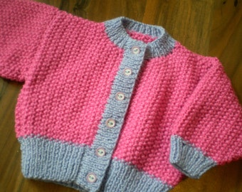 cute pink and lilac hand knitted baby cardigan 0-3 month