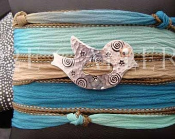 D2E silk yoga wrap bracelet with hand stamped Chickadee bird with riveted star eye  and  magnetic clasp