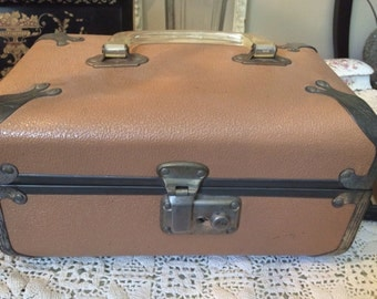 Pink travel-train case with clear handles