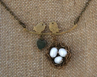 Sweet bird family with nest of three eggs brass necklace