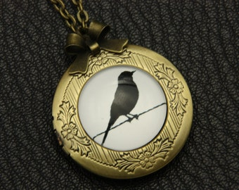 Necklace locket black bird