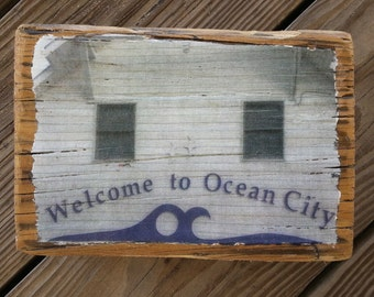 Color photograph of the Welcome to Ocean City Bus Station in Ocean City MD transferred onto reclaimed boardwalk wood
