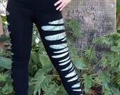 Black Shredded and Sliced Leggings paired with Dollar Bill Digital Print Leggings