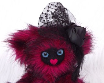 Janebell, 30cm made of raspberry faux fur, black needlefelted face and paws, black fascinator