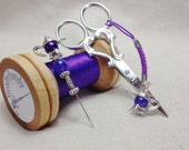 Pearl tea time. Embroidery kit in a wooden bobbin set with scissors and thread catcher.