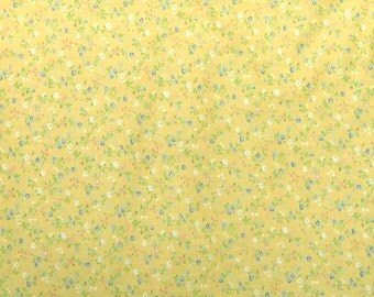 Tiny daisies and blue cornflowers on yellow print
