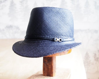 Monique: Modified fedora in navy, brown or black panama straw with hand dyed matching leather trim and small brass finding