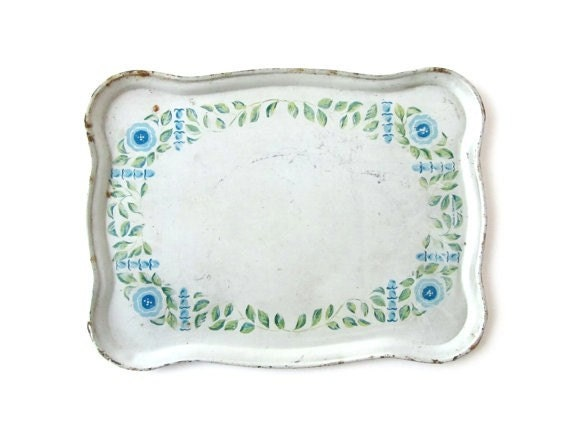 Vintage tin tray with blue floral theme. For a retro touch in your house, it is the cutest home decoration.
