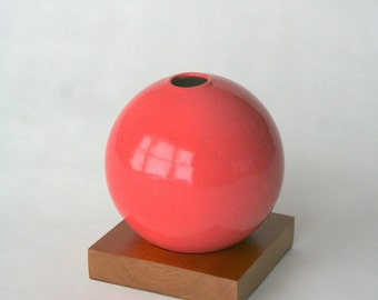 coral pink ceramic vase with cherry wood base