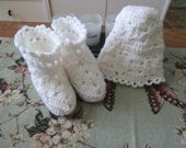 White hat and the Granny square baby shoes.