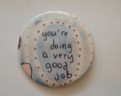 "Large ""you're doing a good job"" button"