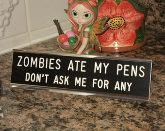 """Zombies Ate My Pens...  engraved 2"""" x 8"""" black sign/white letters - 2 lines with silver desk holder"""