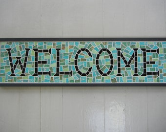Mosaic Welcome sign in blues and greens