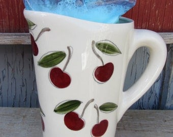 Milk jug for milk bag perfect for the long breakfast on sundays (keeps the milk fresh)with cherries