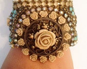 Romantic bracelet - pearl and shining rainstone with lot of cream color roses closes:gold plated chain  hand made.